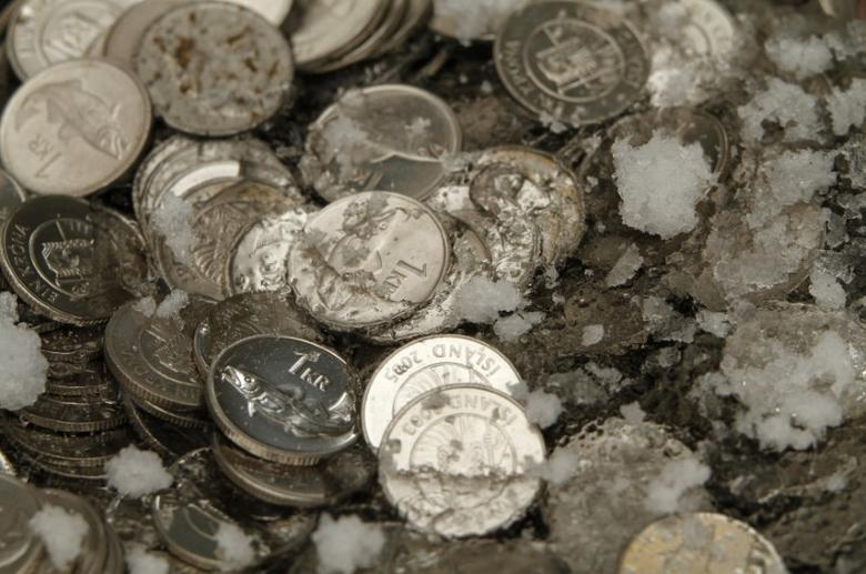 An illustration picture shows Iceland Krona coins in ice in Reykjavik March 6, 2012. REUTERS/Ingolfur Juliusson