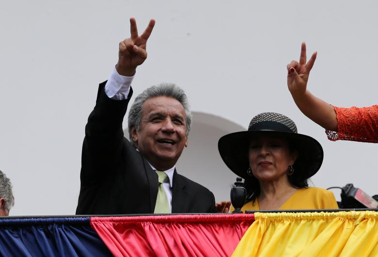Ecuador's Presidential candidate Lenin Moreno (L) stands next to his wife Rocio Gonzalez as he greets supporters from the government palace's balcony during a military change of guard ceremony in Quito, Ecuador April 3, 2017. REUTERS/Mariana Bazo