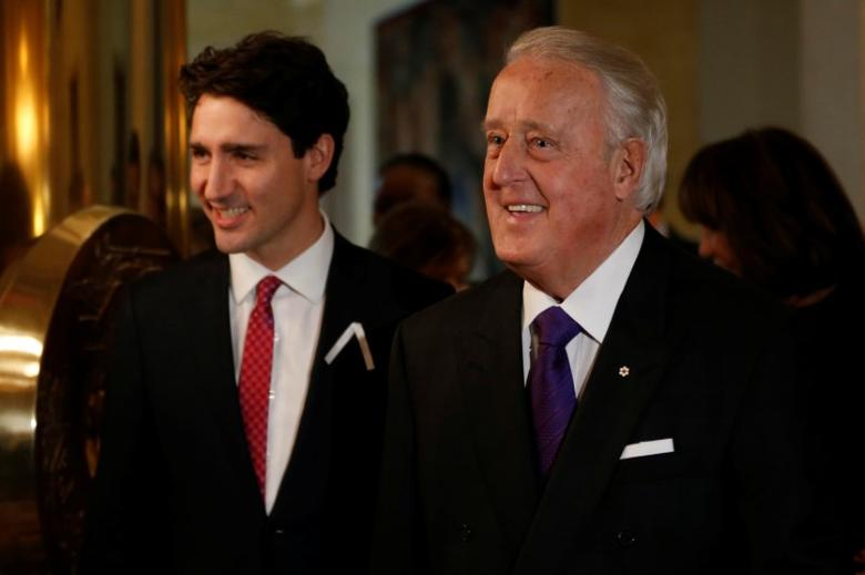Former Canadian Prime Minister Brian Mulroney (R) and Prime Minister Justin Trudeau arrive at a ceremony at the French embassy in Ottawa, Ontario, Canada, December 6, 2016. REUTERS/Chris Wattie