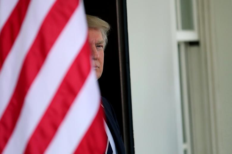 U.S. President Donald Trump waits for the arrival of Egypt's President Abdel Fattah al-Sisi at the White House in Washington. REUTERS/Carlos Barria