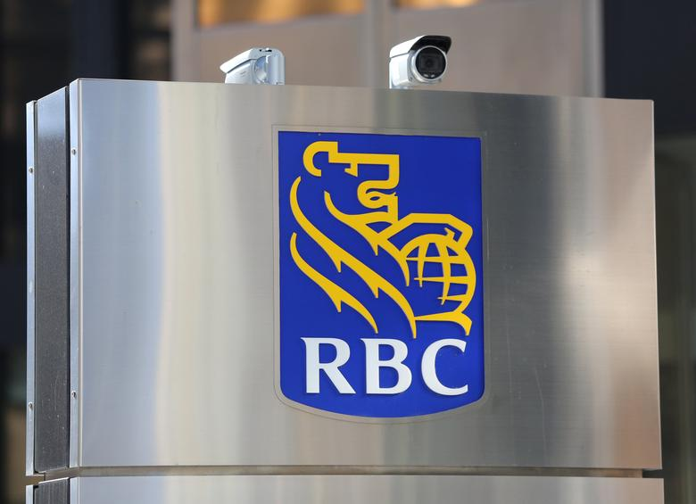 Security cameras point towards pedestrians outside the Royal Bank of Canada (RBC) headquarters in Toronto, Ontario, Canada March 16, 2017. REUTERS/Chris Helgren