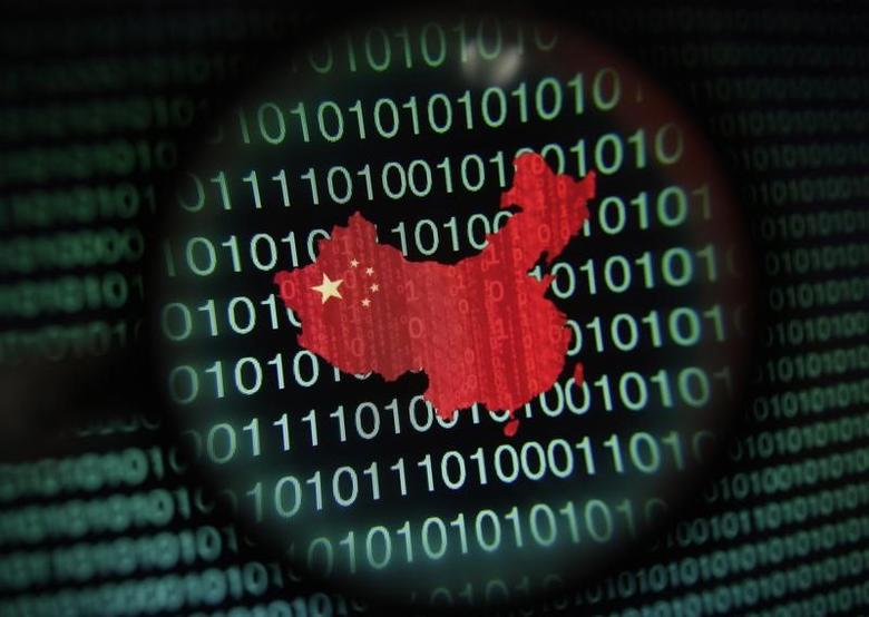 A map of China is seen through a magnifying glass on a computer screen showing binary digits in Singapore in this January 2, 2014 photo illustration. Picture taken January 2, 2014. REUTERS/Edgar Su/Files
