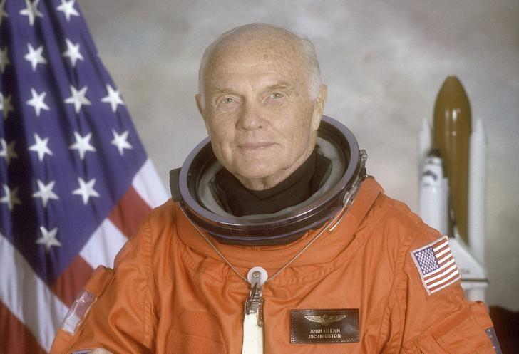 STS-95 crewmember, astronaut and U.S. Senator John Glenn poses for his official NASA photo taken April 14,1998. Glenn was the first American to orbit the earth and returned to space in 1998 aboard the Space Shuttle Discovery.  Courtesy NASA/Handout via REUTERS/Files