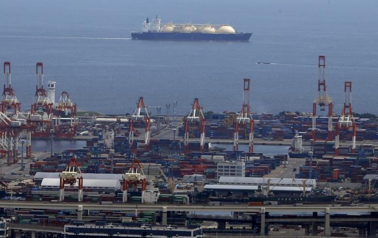 A LNG (Liquefied Natural Gas) tanker is seen behind a port in Yokohama, south of Tokyo, Japan, September 4, 2015. REUTERS/Yuya Shino/File Photo