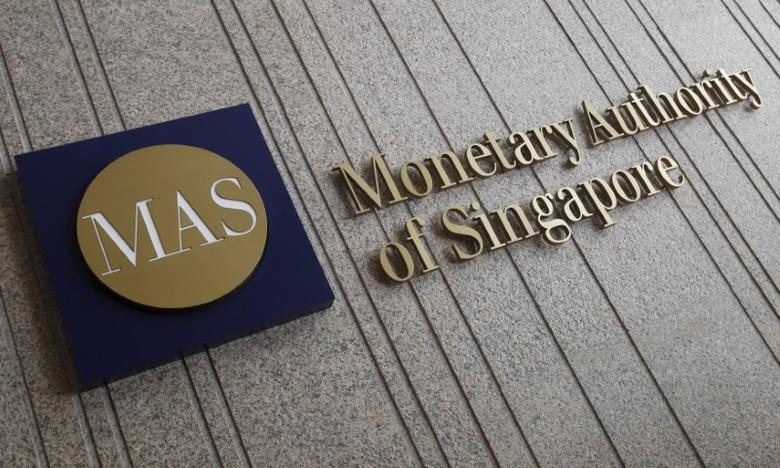 The logo of the Monetary Authority of Singapore (MAS) is pictured at its building in Singapore in this February 21, 2013 file photo.  REUTERS/Edgar Su/File Photo