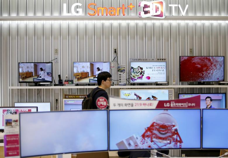 FILE PHOTO: A man looks at LG Electronics' TV sets, which are made with LG Display flat screens, at its store in Seoul, South Korea, April 26, 2016.   REUTERS/Kim Hong-Ji/File Photo