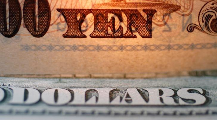 FILE PHOTO: The word ''Yen'' is pictured on a Japanese banknote on top of a U.S. dollar bill at Interbank Inc. Money exchange in Tokyo, Japan in this September 9, 2010 picture illustration.  REUTERS/Yuriko Nakao/File Photo/Illustration