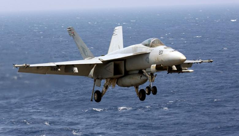 A U.S. Navy F18 fighter flies over the South China Sea as it prepares to land on the deck of USS Carl Vinson during a routine exercise in South China Sea, March 3, 2017. REUTERS/Erik De Castro