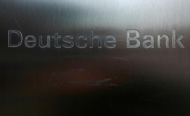 FILE PHOTO: Scratches are seen on the logo of Germany's Deutsche Bank in Frankfurt, Germany, January 26, 2016.  REUTERS/Kai Pfaffenbach/File Photo