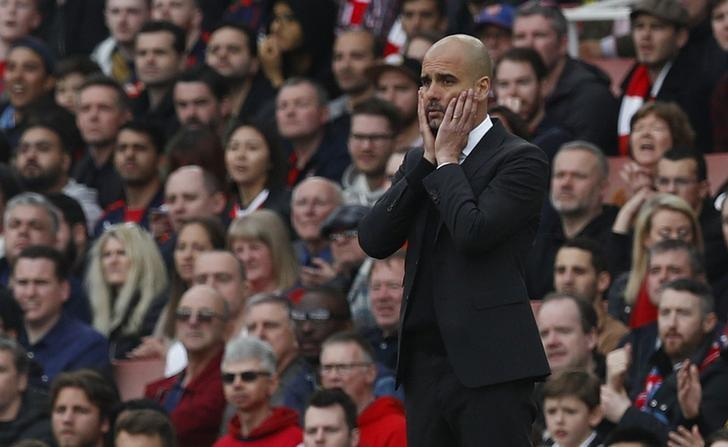 Britain Football Soccer - Arsenal v Manchester City - Premier League - Emirates Stadium - 2/4/17 Manchester City manager Pep Guardiola looks dejected  Reuters / Eddie Keogh Livepic