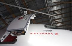 Detail of  Bombardier's CSeries100 aircraft showing their logo and that of Air Canada seen prior to a news conference in Montreal, February 17, 2016.   REUTERS/Christinne Muschi