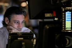 A trader works on the floor of the New York Stock Exchange (NYSE) before the opening bell in the Manhattan borough of New York, U.S. April 4, 2017.   REUTERS/Brendan McDermid