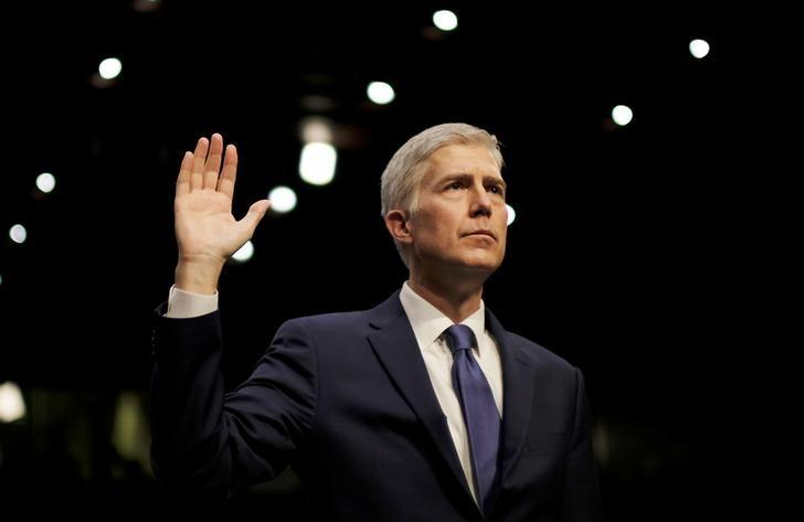 U.S. Supreme Court nominee judge Neil Gorsuch is sworn in to testify at his Senate Judiciary Committee confirmation hearing on Capitol Hill in Washington, U.S., March 20, 2017. REUTERS/James Lawler Duggan/File Photo