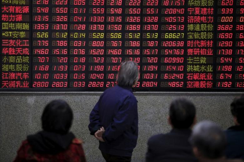 Investors look at an electronic board showing stock information at a brokerage house in Shanghai, China, March 7, 2016. REUTERS/Aly Song/File Photo