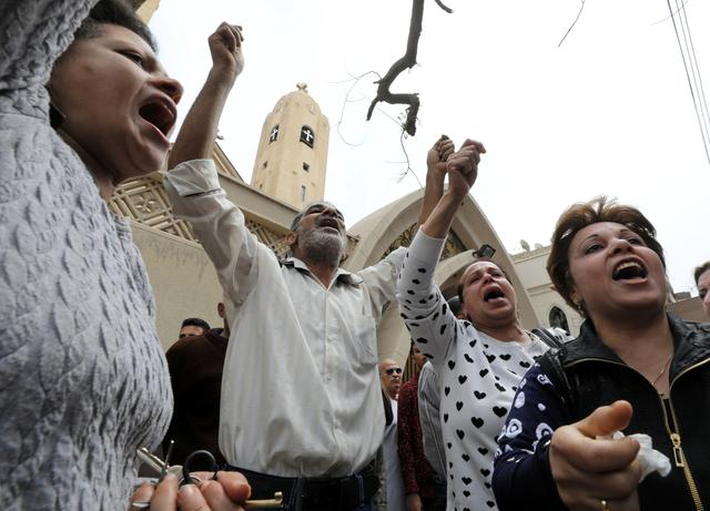 Relatives of victims react in front of a Coptic church that was bombed on Sunday in Tanta, Egypt, April 9, 2017.  REUTERS/Mohamed Abd El Ghany