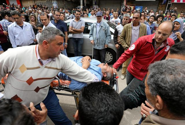 A victim is seen on a stretcher after a bomb went off at a Coptic church in Tanta, Egypt, April 9, 2017. REUTERS/Mohamed Abd El Ghany