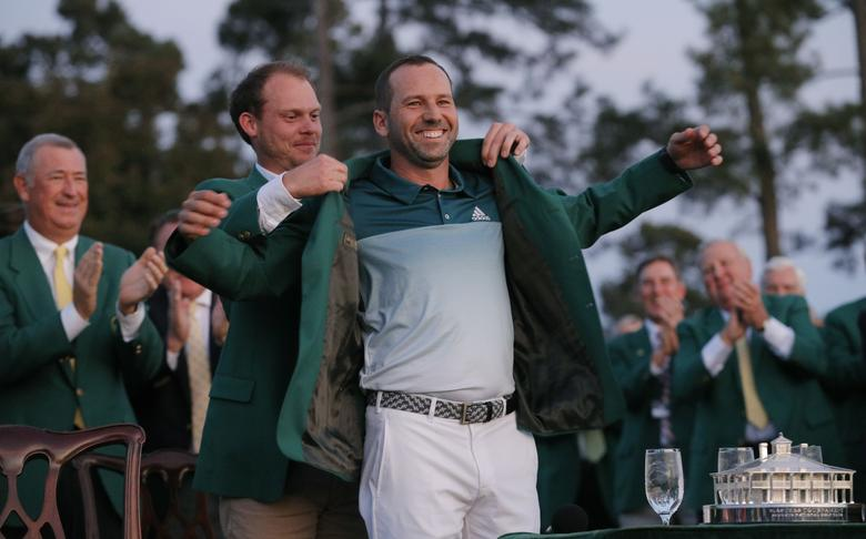 Sergio Garcia of Spain smiles as he is presented the green jacket by last year's champion, Danny Willett of England, after Garcia won the 2017 Masters golf tournament in a playoff at Augusta National Golf Club in Augusta, Georgia, U.S., April 9, 2017. REUTERS/Mike Segar