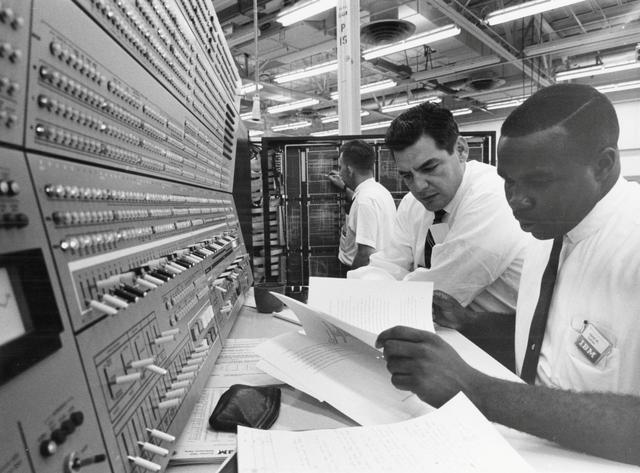 IBM engineers work with a System 360 mainframe computer using business programs written in an early version of the COBOL language in this undated handout photo obtained by Reuters March 31, 2017.   IBM/Handout via REUTERS