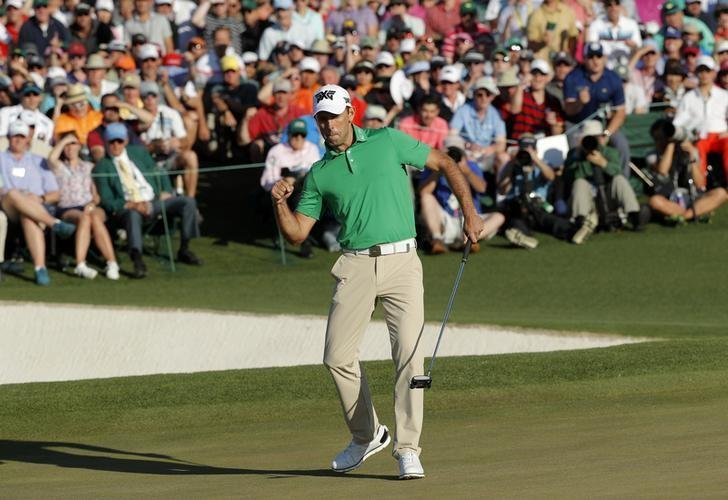 Charl Schwartzel of South Africa celebrates a birdie putt on the 18th green in final round play during the 2017 Masters golf tournament at Augusta National Golf Club in Augusta, Georgia, U.S., April 9, 2017. REUTERS/Mike Segar