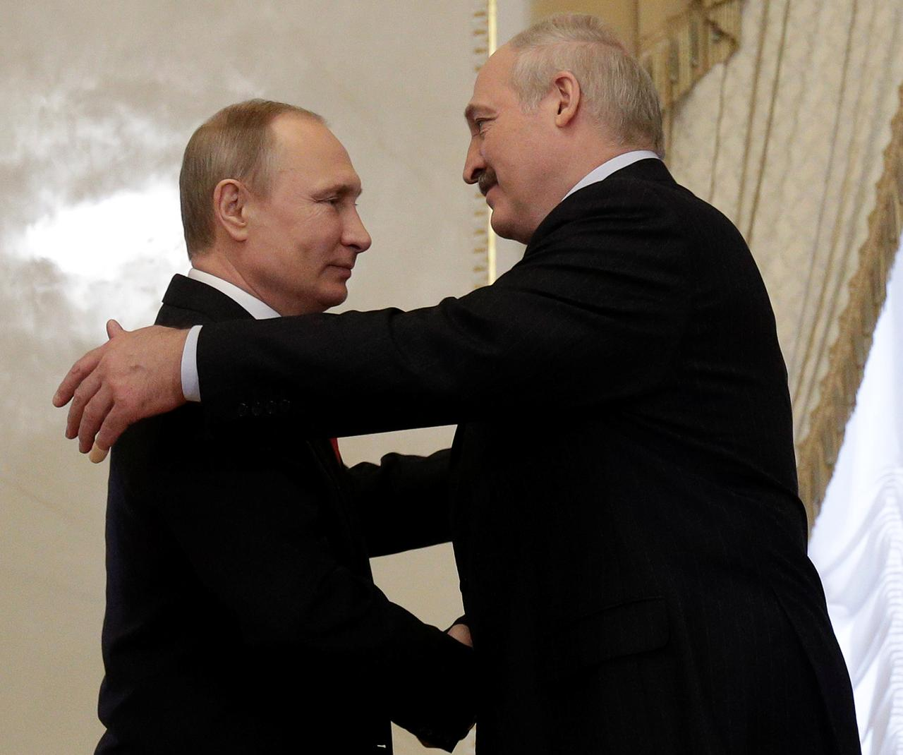 Belarus says russia promises new loans of over 1 billion russian president vladimir putin greets belarus president alexander lukashenko during their meeting at konstantin palace in st petersburg russia april 3 kristyandbryce Images