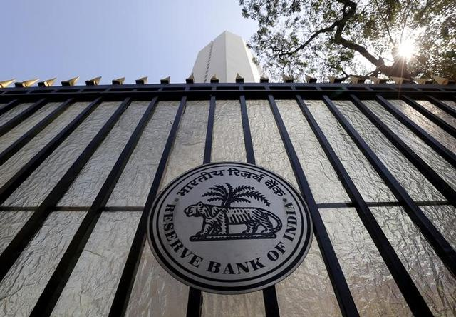 FILE PHOTO: The Reserve Bank of India (RBI) seal is pictured on a gate outside the RBI headquarters in Mumbai, February 2, 2016. REUTERS/Danish Siddiqui/File photo