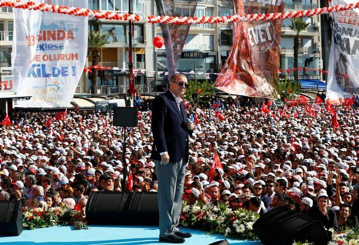 Turkish President Tayyip Erdogan addresses his supporters during a rally for the upcoming referendum, in Izmir, Turkey, April 9, 2017. REUTERS/Umit Bektas