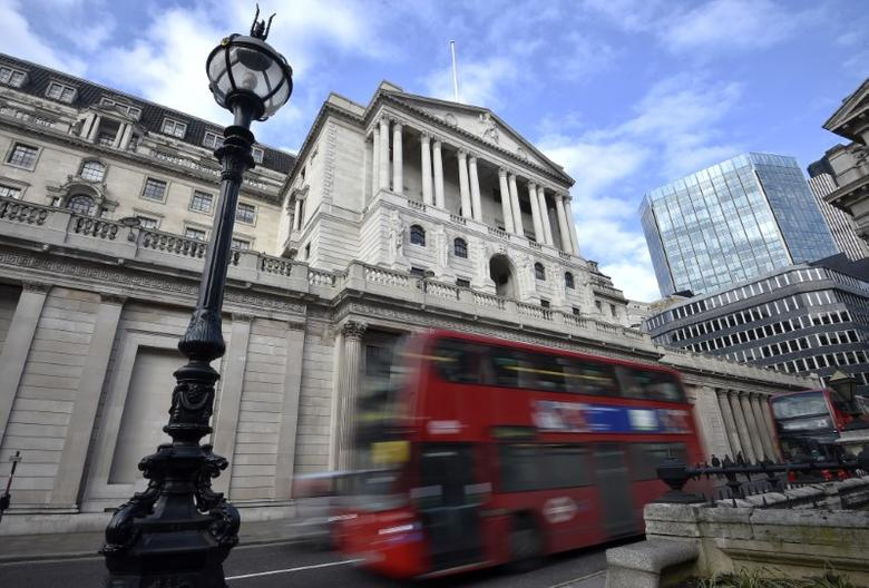A bus passes the Bank of England in the City of London, Britain, February 14, 2017. REUTERS/Hannah McKay