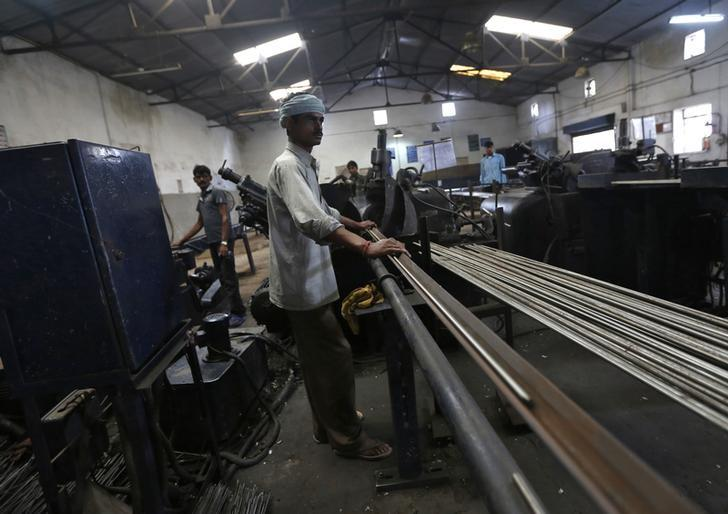 Employees work at the production line inside Hallmark steel factory in Bhiwadi in the desert Indian state of Rajasthan September 30, 2013. REUTERS/Adnan Abidi/files