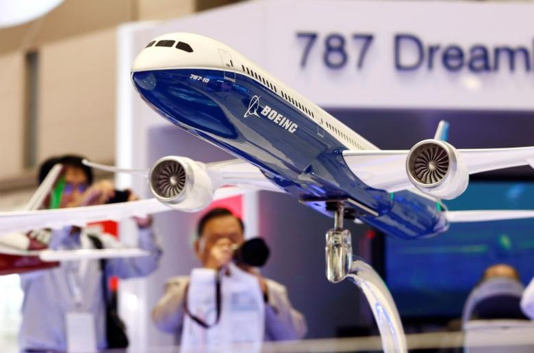 Visitors take pictures of a model of Boeing's 787 Dreamliner during Japan Aerospace 2016 air show in Tokyo, Japan, October 12, 2016.   REUTERS/Kim Kyung-Hoon