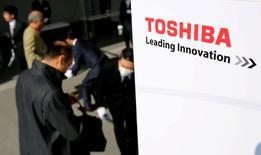 FILE PHOTO: The logo of Toshiba is seen as shareholders arrive at Toshiba's extraordinary shareholders meeting in Chiba, Japan, March 30, 2017. REUTERS/Toru Hanai/File Photo