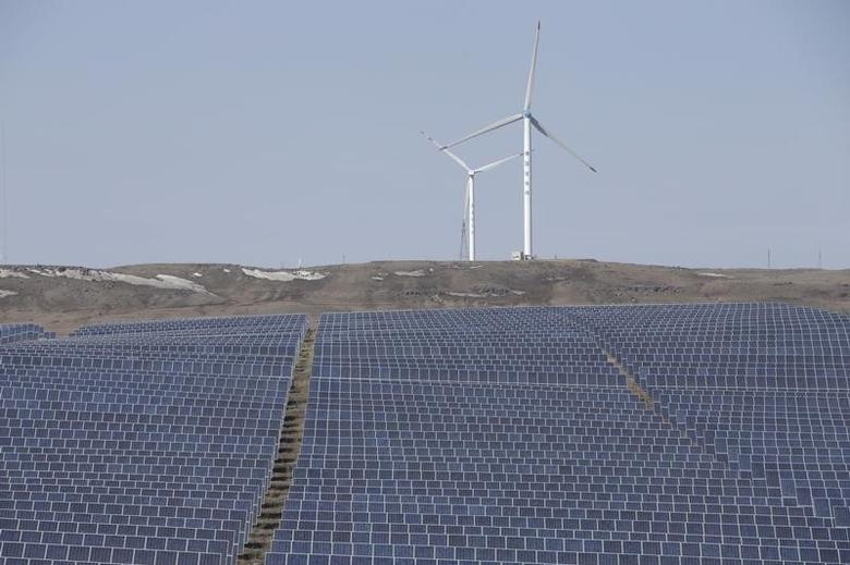 FILE PHOTO: Wind turbines and solar panels are seen at a wind and solar energy storage and transmission power station from State Grid Corporation of China, in Zhangjiakou of Hebei province, China, March 18, 2016. REUTERS/Jason Lee/File Photo