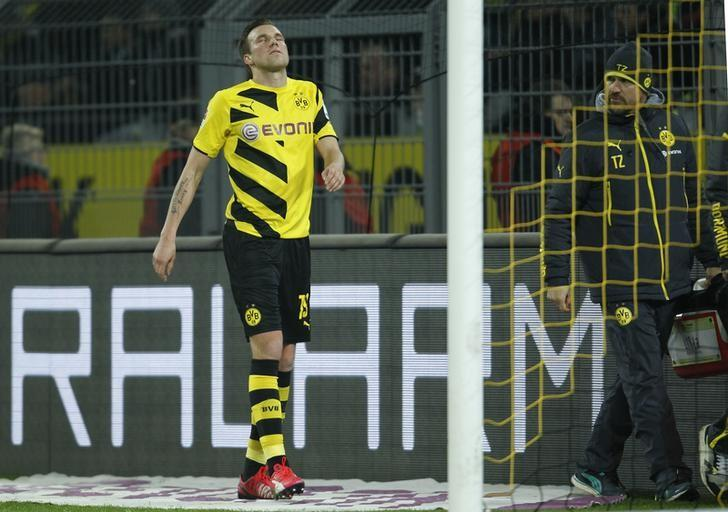 Borussia Dortmund's Kevin Grosskreutz leaves the pitch following an injury during his team's Bundesliga soccer match against FC Augsburg in Dortmund February 4, 2015.   REUTERS/Ina Fassbender/File Photo