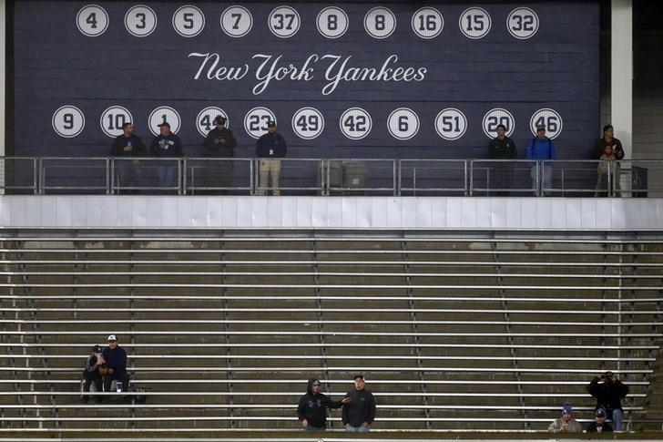Sep 30, 2016; Bronx, NY, USA; Fans look on in the rain during the first inning of a baseball game between the Baltimore Orioles and the New York Yankees at Yankee Stadium. Mandatory Credit: Adam Hunger-USA TODAY Sports