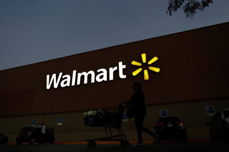 A shopper pushes a cart outside a Walmart store in Monterrey, Mexico March 6, 2017. REUTERS/Daniel Becerril