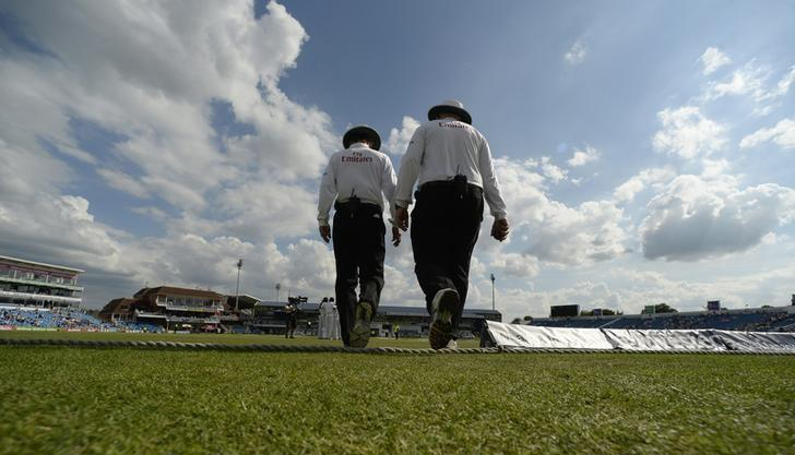 Umpire Billy Bowden and Steve Davis (R) walk on to the field during the second cricket test match between England and Sri Lanka at Headingley cricket ground in Leeds, England June 23, 2014.  REUTERS/Philip Brown/Files