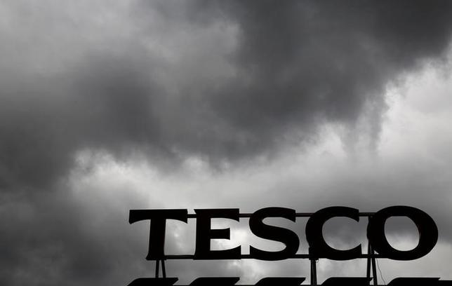 FILE PHOTO: Grey clouds hang over a Tesco Extra store in New Malden, London, Britain, June 4, 2014. REUTERS/Luke MacGregor/File Photo