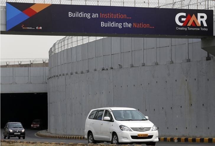 Vehicles cross through an underpass constructed by GMR Infrastructure that connects to the airport in New Delhi, May 13, 2013. REUTERS/Anindito Mukherjee/Files