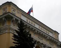 A Russian national flag flies over the Central Bank headquarters in Moscow, Russia, May 17, 2016. REUTERS/Sergei Karpukhin/File Photo               GLOBAL BUSINESS WEEK AHEAD PACKAGE Р SEARCH ТBUSINESS WEEK AHEAD SEPTEMBER 12У FOR ALL IMAGES