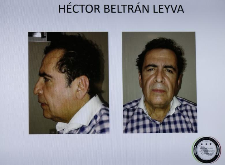 Pictures of the head of the Beltran Leyva drug cartel Hector Beltran Leyva are seen displayed on a television screen during a news conference at the Attorney General's Office building in Mexico City October 1, 2014, in this handout courtesy of the office.  REUTERS/Attorney General's Office/Handout via Reuters