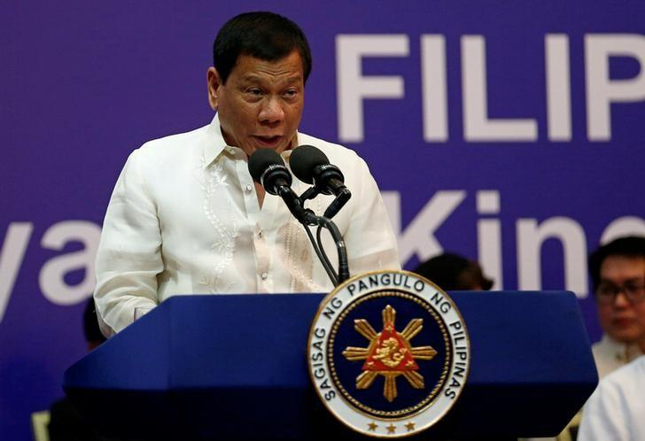 Philippine President Rodrigo Duterte speaks during a meeting with the Filipino community in Riyadh, Saudi Arabia, April 12, 2017. REUTERS/Faisal Al Nasser