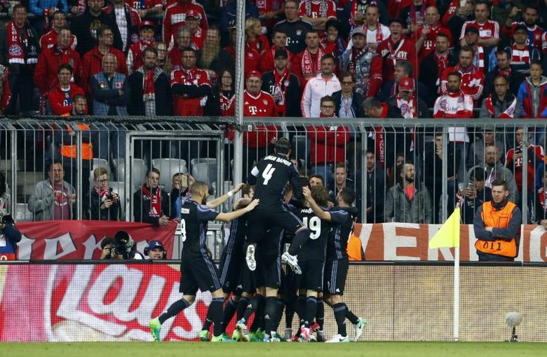 Football Soccer - Bayern Munich v Real Madrid - UEFA Champions League Quarter Final First Leg - Allianz Arena, Munich, Germany - 12/4/17 Real Madrid's Cristiano Ronaldo celebrates scoring their first goal with team mates  Reuters / Michaela Rehle Livepic