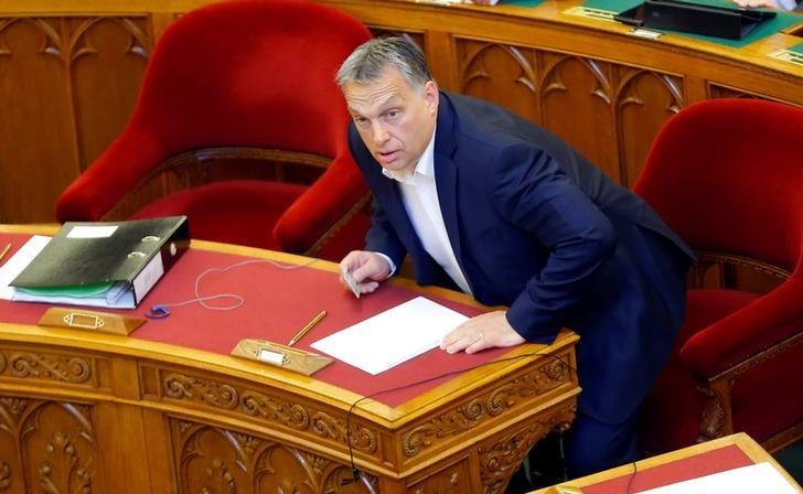 FILE PHOTO: Hungarian Prime Minister Viktor Orban arrives to a vote on a bill tightening regulations on foreign universities operating in Hungary, effectively pushing out of the country Central European University, a school founded by U.S. billionaire philanthropist George Soros, in Budapest, Hungary, April 4, 2017. REUTERS/Laszlo Balogh
