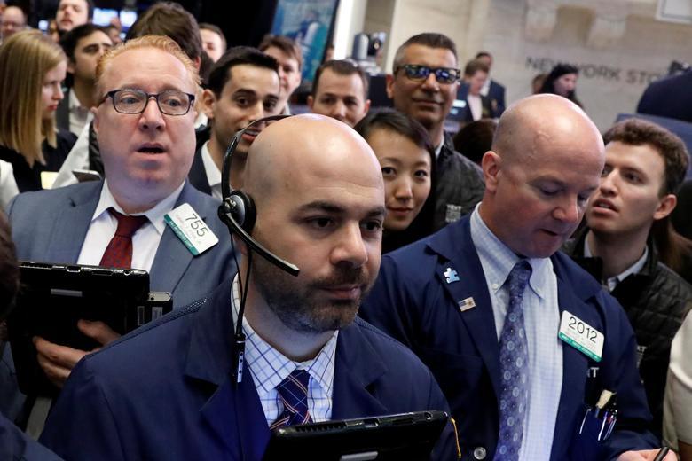 Traders work on the floor of the New York Stock Exchange (NYSE) in New York, U.S., April 13, 2017. REUTERS/Brendan McDermid