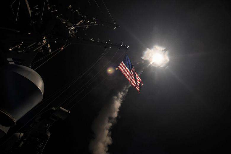 FILE PHOTO: U.S. Navy guided-missile destroyer USS Porter (DDG 78) conducts strike operations while in the Mediterranean Sea which U.S. Defense Department said was a part of cruise missile strike against Syria  on April 7, 2017.  Ford Williams/Courtesy U.S. Navy/Handout via REUTERS/File Photo
