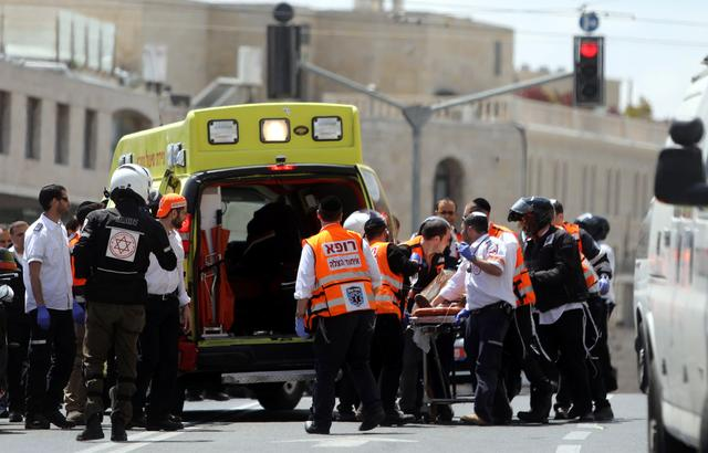 Israeli medics evacuate an injured person following a stabbing attack just outside Jerusalem's Old City, according to Israeli police, April 14, 2017. REUTERS/Ammar Awad