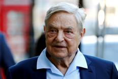 FILE PHOTO -- Business magnate George Soros arrives to speak at the Open Russia Club in London, Britain June 20, 2016. REUTERS/Luke MacGregor/File Photo