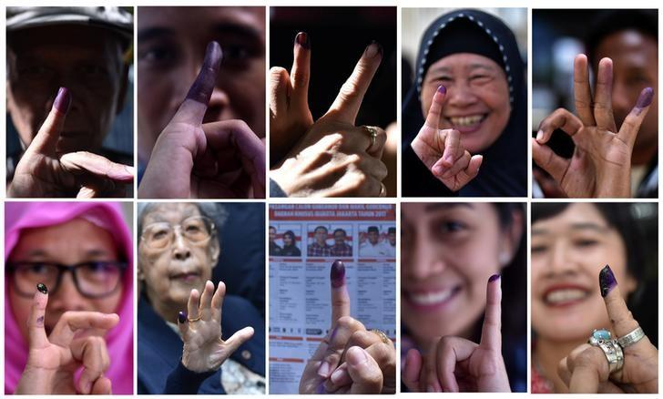 A combination picture shows people raising their finger after voting during an election for Jakarta's governor in Jakarta, Indonesia February 15, 2017. Antara Foto/Wahyu Putro via REUTERS