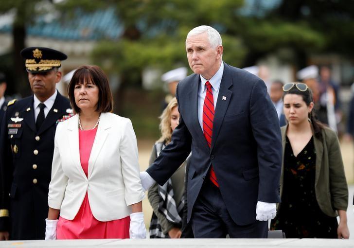 U.S. Vice President Mike Pence visits the National Cemetery in Seoul, South Korea, April 16, 2017.  REUTERS/Kim Hong-Ji