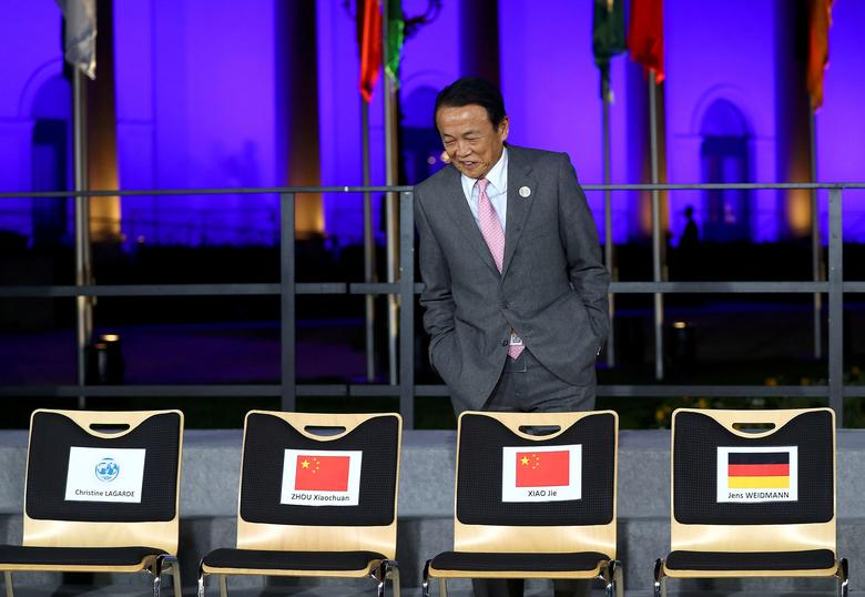 Japanese Finance Minister Taro Aso arrives for the family photo at the G20 Finance Ministers and Central Bank Governors Meeting in Baden-Baden, Germany, March 17, 2017.   REUTERS/Kai Pfaffenbach