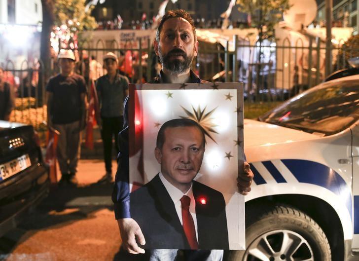 A supporter of Turkish President Tayyip Erdogan celebrates in Istanbul, Turkey, April 16, 2017. REUTERS/Alkis Konstantinidis